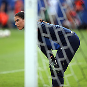 U.S. goalkeeper Hope Solo (1) warms us prior to an international friendly soccer match between the United States Women's National soccer team and the Russia National soccer team at FAU Stadium on Saturday, February 8, in Boca Raton, Florida. The U.S. won the match by a score of 7-0. (AP Photo/Alex Menendez)