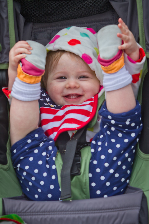 One year old, Daisey Grace Kelly, is excited for the start of the Fourth of July Parade, downtown Anchorage.