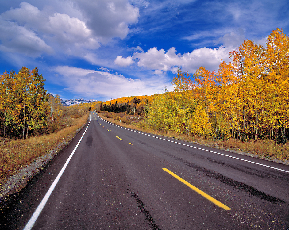 The colors of autumn fill this view of Highway 550, on Red Mountain Pass, Colorado