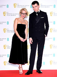 Gillian Anderson and Asa Butterfield in the press room at the 73rd British Academy Film Awards held at the Royal Albert Hall, London.