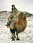 Abdul Sator coming back on a Bactrian camel after locating the yak herd..Campment of Ortobil (Sufi), all the way at the end of the Little Pamir, near the Tajik/China border.
