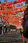 Londons Chinatown still festooned with lanterns from the Chinese new year, left up months later over an empty street during the Coronavirus pandemic on 23th April 2020 in London, United Kingdom. The government clampdown includes the closure of most shops, bars and theatres throughout the country.