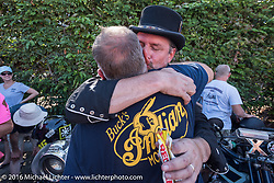 This is the end my friend, 3,400 miles from the Atlantic to the Pacific. The journey is over. A very happy Scott Byrd congratulates Buck Rinker at the finish line of the Motorcycle Cannonball Race of the Century. Stage-15 ride from Palm Desert, CA to Carlsbad, CA. USA. Sunday September 25, 2016. Photography ©2016 Michael Lichter.
