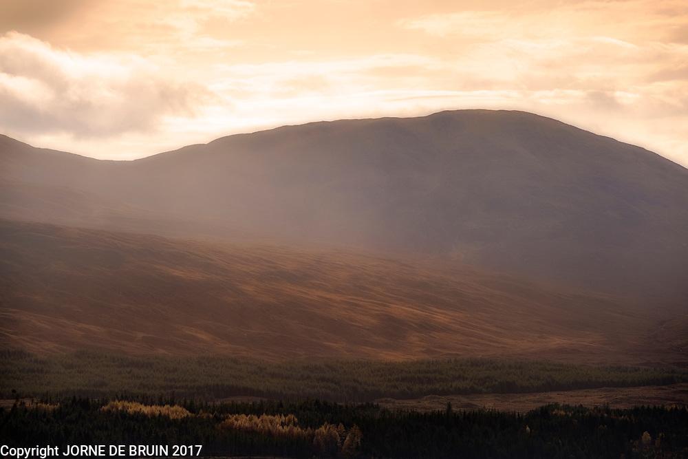 Spectacular golden light over the scottisch highlands in autumn colours.
