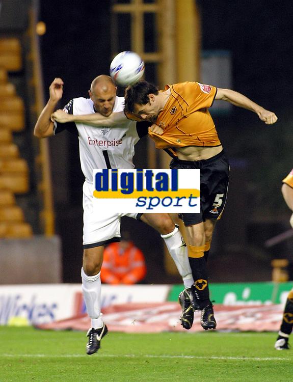 Photo: Dave Linney.<br />Wolverhampton Wanderers v Preston North End. Coca Cola Championship. 11/08/2006Preston's .Danny Dichion(L) in a heading dual with Gary Breen