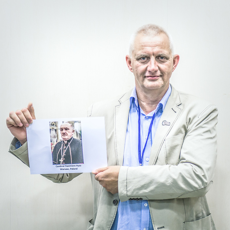 2018<br /> Marek Lisinski, a survivor and an activist from Poland, poses for a portrait showing a picture of Cardinal Kazimierz Nycz who covers up sexual abuse of several children by Koszalin-Kolobrzeg priest. © Simone Padovani