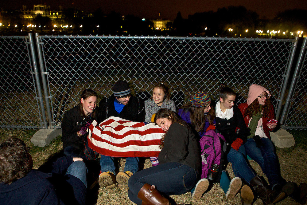 Students from George Washington University try to keep warm as they show their continued support of President Barack Obama on Wednesday, Nov. 7, 2012 in Washington, D.C. The group, all of whom voted for the first time in Tuesday's election, waited outside of the White House to catch a glimpse of the President as he returned to Washington from Chicago on Wednesday evening.