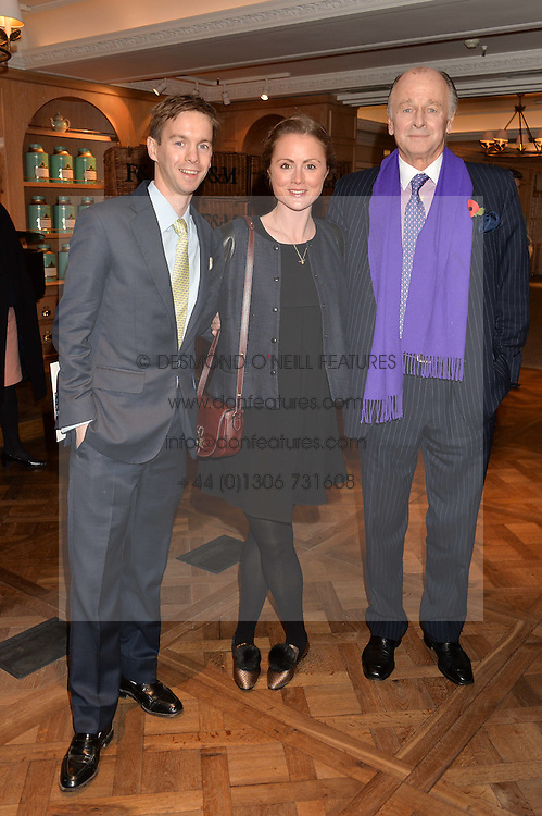 Left to right, SAM & LOUISA PARKER BOWLES and his father SIMON PARKER BOWLES at a party to celebrate the publication of 'Let's Eat meat' by Tom Parker Bowles held at Fortnum & Mason, Piccadilly, London on 21st October 2014.