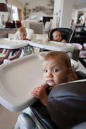 25th August 2011. Dana Point, California. DeAun Nixon, who has given birth to a set of triplets for herself and a set of surrogate triplets for her friends Larry & Kristina Dodge. Pictured are Larry (suit), Kristina  (tan dress), DeAun (red dress), Austin (eldest, purple shirt / black T)  11-year-old triplets - Nicholas (purple shirt), Thomas (striped polo) and Alexa Bhardwaj (purple dress).  6 month old triplets, Tatiani , Alexandra and Cozette Dodge, and Laurenz Dodge (blue top and jeans).Photo © John Chapple / www.chapple.biz