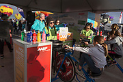 Tasha Kankaanpaa holds up spin bike artwork at the AARP Block Party at the Albuquerque International Balloon Fiesta in Albuquerque New Mexico USA on Oct. 7th, 2018.