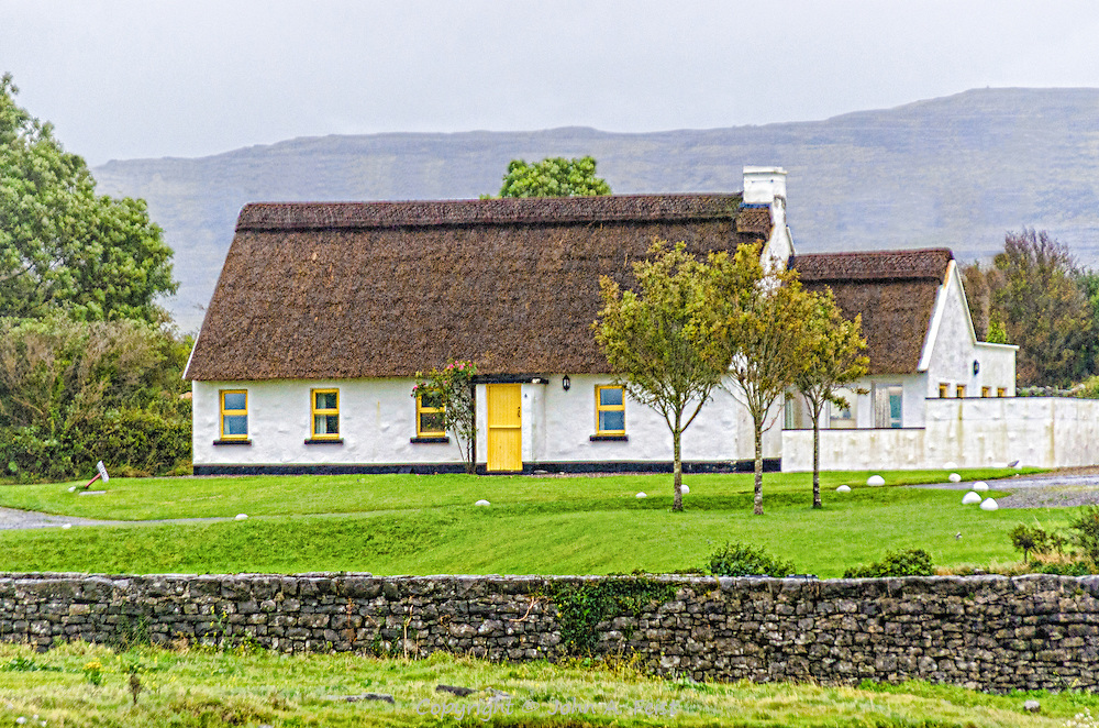 We had been driving over hill and dale and detours in western Ireland when we came upon this cottage.  It is about as traditional as it gets.  The rood is thatch, the building is local stone.
