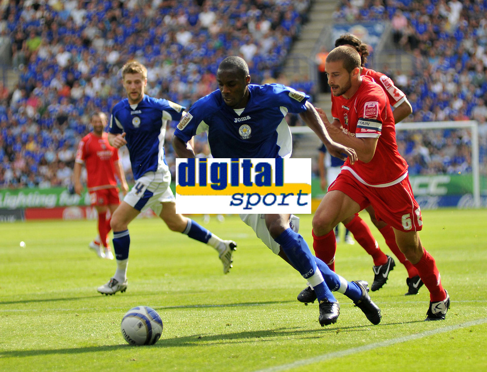 Photo: Tony Oudot/Richard Lane Photography. Leicester City v Barnsley. Coca Cola Championship. 22/08/2009. <br /> Danny N'Guessan of Leicester is chased by Stephen Foster of Barnsley