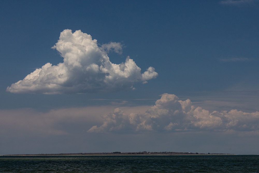 Mainland clouds towering over the landscape of Tuckernuck Island on a warm springtime afternoon.