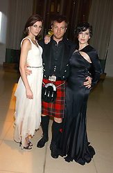 Left to right, LIBERTY ROSS, EWAN McGREGOR and SHARLEEN SPITERI at a Burns Night supper in aid of Clic Sargent & Children's Hospital Association Scotland hosted by Ewan McGregor, Sharleen Spieri and Lady Helen Taylor at St.Martin's Lane Hotel, 45 St Martin's Lane, London on 25th January 2006.<br /><br />NON EXCLUSIVE - WORLD RIGHTS