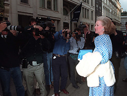 Raine Spencer, Comtesse de Chambrun, faces a bank of photographers as she leaves Christie's, St James', this evening (Monday) after a private viewing of her step-daughter's evening gowns. Diana, Princess of Wales, is auctioning 79 dresses for charity in New York on June 25. Photo by DAVID GILES/PA. SEE PA STORY ROYAL Diana Nightlead.