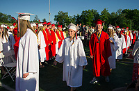 Laconia High School graduating class of 2018 processional into Fitzgerald Field for the 140th commencement exercises on Friday evening.  (Karen Bobotas/for the Laconia Daily Sun)
