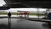 1929 Brunner Winkle Bird A, owned earlier by Melba Beard - charter member of the 99s - then inherited by Arlene Beard, being pushed into hangar.