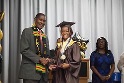 M'Kaylah Sullivan receives her diploma from principal Dr. Whitman Brown.  St. Thomas/St. John Seventh Day Adventist School Commencement Service.  Bertha C. Boschulte Auditorium.  St. Thomas, USVI.  12 June 2016.  © Aisha-Zakiya Boyd