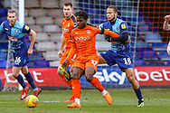 Wycombe Wanderers midfielder Curtis Thompson holds back Luton Town midfielder Pelly-Ruddock Mpanzu during the EFL Sky Bet League 1 match between Luton Town and Wycombe Wanderers at Kenilworth Road, Luton, England on 9 February 2019.