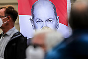 A poster of SPD chancellor candidate and current Finance Minister Olaf Scholz during an election campaign event of the German Social Democratic Party (SPD) at Bebelplatz square In Berlin, Germany, August 27, 2021. Germany's federal elections are due to take place on September 26, 2021.