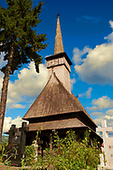 Greco Catholic Wooden Church of Adormirea Maiccii Domnului, Maramures, Northern Transylvania, Romania, UNESCO World Heritage Site .<br /> <br /> Visit our ROMANIA HISTORIC PLACXES PHOTO COLLECTIONS for more photos to download or buy as wall art prints https://funkystock.photoshelter.com/gallery-collection/Pictures-Images-of-Romania-Photos-of-Romanian-Historic-Landmark-Sites/C00001TITiQwAdS8<br /> .<br /> Visit our MEDIEVAL PHOTO COLLECTIONS for more   photos  to download or buy as prints https://funkystock.photoshelter.com/gallery-collection/Medieval-Middle-Ages-Historic-Places-Arcaeological-Sites-Pictures-Images-of/C0000B5ZA54_WD0s