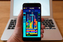 Detail of Tetris game on an iPhone smart phone