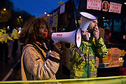 Valerie Brown, Burning Pink London Mayoral candidate, addresses activists from groups including Kill The Bill, United for Black Lives UBL and Stop HS2 as Metropolitan Police officers block access to the Westway to all those attending a March On The Motorway event organised by Burning Pink to coincide with the eve of the London Mayoral elections on 5th May 2021 in London, United Kingdom. Burning Pink is a radical political party campaigning for rapid action to combat the climate emergency, among other issues, through the setting up of citizens assemblies.