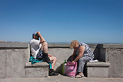 A middle-aged couple look uninspired during their afternoon in Cascais, near Lisbon, Portugal.