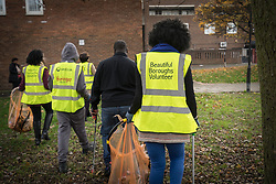 Local residents picking up litter at the Community Safety & Wellbeing Day in Tottenham, London 2016. LB Haringey UK