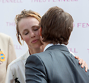 © Licensed to London News Pictures. 31/07/2014. Chichester, UK Hollywood actor Tom Cruise kisses supermodel Edie Campbell after she wins first place in the Ladies Race.  Ladies Day at Glorious Goodwood at Goodwood racecourse in Chichester today 31/07/14. Photo credit : Stephen Simpson/LNP