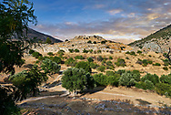 View of Mycenae Necropolis and Palace ruins, Mycenae Archaeological Site, Peloponnese, Greece . <br /> <br /> Visit our MYCENAEN ART PHOTO COLLECTIONS for more photos to download  as wall art prints https://funkystock.photoshelter.com/gallery-collection/Pictures-Images-of-Ancient-Mycenaean-Art-Artefacts-Archaeology-Sites/C0000xRC5WLQcbhQ<br /> .<br /> <br /> Visit our GREEK HISTORIC PLACES PHOTO COLLECTIONS for more photos to download or buy as wall art prints https://funkystock.photoshelter.com/gallery-collection/Pictures-Images-of-Greece-Photos-of-Greek-Historic-Landmark-Sites/C0000w6e8OkknEb8
