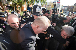 © Licensed to London News Pictures. 07/12/2011. London, UK. Entertainer Michael Barrymore being given a police escort while leaving Ealing Magistrates Court today (07/12/2011) where he pleaded guilty to possessing cocaine and was  fined £680 plus £100 in costs, following his arrest at the scene of a car crash last month.. The 59-year-old was held at 4.30am on November 22 after a Citroen DS3 hit a kerb in Acton, west London.. Photo credit: Ben Cawthra/LNP