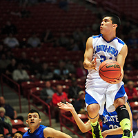 031413  Adron Gardner/Independent<br /> <br /> Laguna Acoma Hawk Anthony Caprio (21) floats on a layup attempt  during the 2A New Mexico High School Basketball title game against the Dexter Demons at The Pit in Albuquerque Saturday.