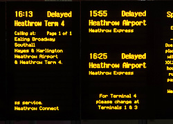 © Licensed to London News Pictures. 27/12/2013. London, UK. A sign at Paddington rail station shows services to Heathrow are delayed.  Rail services having been disrupted as a result of adverse weather conditions over the Christmas period. Photo credit : Richard Isaac/LNP