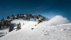 THEMENBILD - ein Skifahrer im Tiefschnee bei strahlendem Wetter mit Bergkulisse, aufgenommen am 27.03.2014 in Kaprun, Österreich // a skier in deep snow in glorious weather with mountain backdrop, Kaprun, Austria on 2014/03/27. EXPA Pictures © 2014, PhotoCredit: EXPA/ JFK