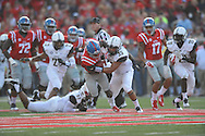Mississippi Rebels running back Jaylen Walton (6) runs against Vanderbilt Commodores linebacker Darreon Herring (35) at Vaught-Hemingway Stadium at Ole Miss in Oxford, Miss. on Saturday, September 26, 2015. (AP Photo/Oxford Eagle, Bruce Newman)