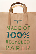 brown paper shopping bag with the big printed text Made of 100% Recycled Paper