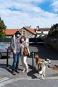 couple walking their dogs during the Covid 19 crisis and lockdown France Limoux April 2020