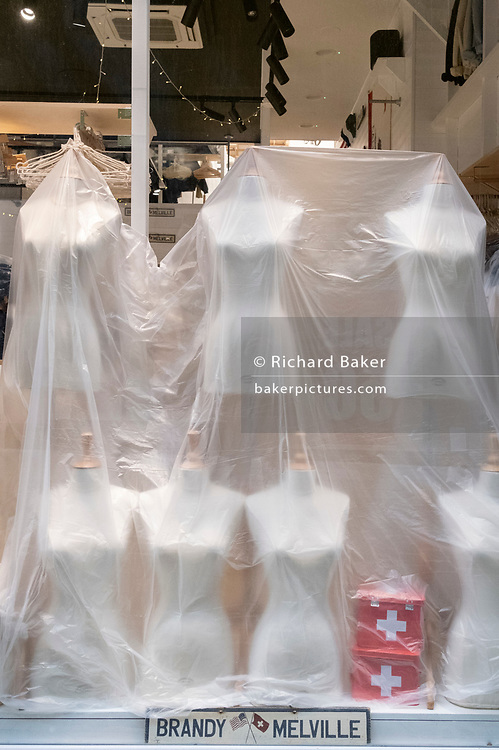 Dust covers protect expensive shop window dummies in a closed Neal Street branch of Brandy Melville during the third lockdown of the Coronavirus pandemic, on 22 February 2021, in London, England. Brandy Melville is a European clothing and fashion accessories brand, marketing their products to young women. The company was established in Italy by Silvio Marsan but attracted most of its popularity in California.