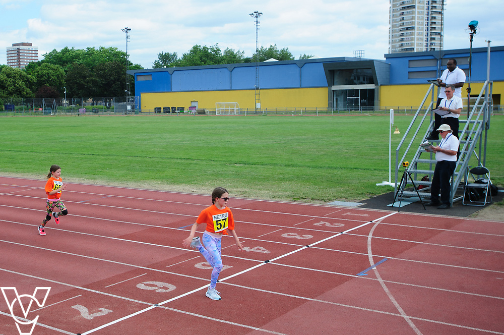 Event: 60 meters<br /> Competitors, from left: Maisie Austin and Annie Austin<br /> <br /> Metro Blind Sport's 42nd Athletics Open, held at Mile End Stadium, Tower Hamlets, London.<br /> <br /> Picture: Chris Vaughan Photography for Metro Blind Sports<br /> Date: June 16, 2018