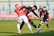 Salford City Tom Clarke (6) Scunthorpe United Scunthorpe United Myles Hippolyte (15) battles for possession during the EFL Sky Bet League 2 match between Salford City and Scunthorpe United at the Peninsula Stadium, Salford, United Kingdom on 6 March 2021.