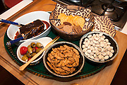 Hors doeuvres snack tray with crackers nuts olives and cheese. St Paul Minnesota MN USA