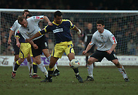 Photo: Ian Hebden.<br />Luton Town v Derby County. Coca Cola Championship. 18/03/2006.<br />Derby's Kevin Lisbie (C) shields the ball from Luton's Paul Underwood (L) and Steve Robinson (R).