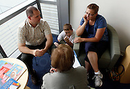 Leslie Frantzen (R) talks with a counselor in the Shapedown Program at The Children's Hospital with husband Mark and son Zachary in Aurora, Colorado July 8, 2010.  Zachary is a patient in the Shapedown Program, part of the child and teen weight management programs at the hospital.  REUTERS/Rick Wilking (UNITED STATES)