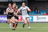Hallam Amos (L) of the Newport Gwent Dragons runs past Dan Fish (R)  of the Cardiff Blues. Guinness Pro12 rugby match, Cardiff Blues v Newport Gwent Dragons at the Cardiff Arms Park in Cardiff, South Wales on Sunday 17th April 2016.<br /> pic by Simon Latham, Andrew Orchard sports photography.