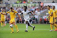 Wilfried Bony of Swansea city chases Ovidiu Hoban of Petrolul Ploiesti <br /> UEFA Europa league, play off round, 1st leg match, Swansea city v FC Petrolul Ploiesti at the Liberty stadium in Swansea on Thursday 22nd August 2013. pic by Phil Rees , Andrew Orchard sports photography,
