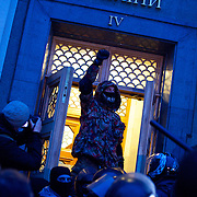 KIEV, UKRAINE - February 24, 2014: Anti-government protestors try to storm the parliament building in central Kiev, moments after the proposal for release of political prisoners was rejected by majority vote in a parliamentary session. CREDIT: Paulo Nunes dos Santos