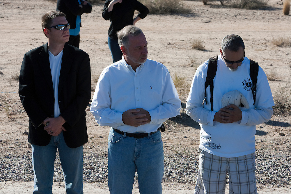 Thousands of mourners line North Shannon Rd to honor slain 9 year old Christina Green who died in the shooting rampage on January 8, 2011 in Tucson, Arizona.