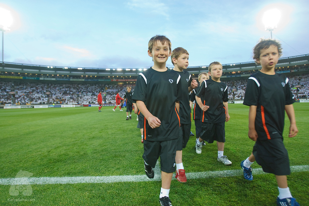 A group of children walk off the field right before the start of the second leg of the FIFA 2010 World Cup qualifying match opposing the New Zealand All Whites and Bahrain, at Westpac Stadium on november 14, 2009. The match was attended by more than 35,100 spectators, the largest crowd for a football match in New Zealand.