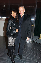JACKIE ST.CLAIR and CARL MICHAELSON at a party to celebrate the launch of Pilsner Urquell beer held in the Pavillion at The Serpentine Gallery, London on 4th October 2006.<br /><br />NON EXCLUSIVE - WORLD RIGHTS